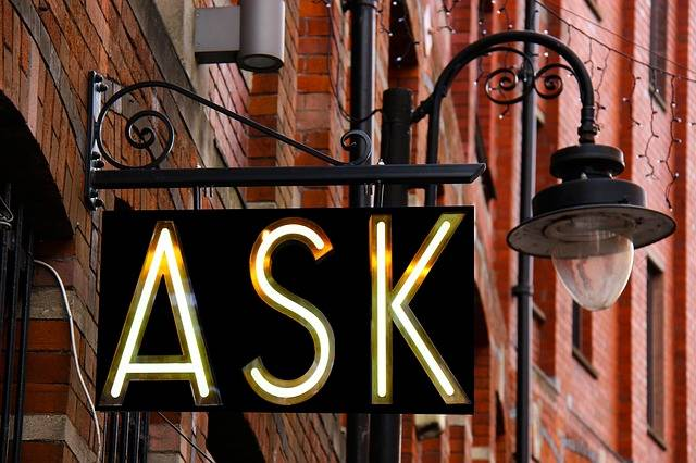 ASK neon sign to advertise frequently asked eye care questions